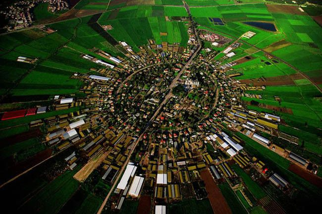 Moshav Cooperative Farm in Israel - based on concentric circles, with the public buildings (school, administrative and cultural offices, cooperative shops and warehouses) in the center, the homesteads in the innermost circle, the farm buildings in the next, and beyond those, ever-widening circles of gardens and fields.  By 1986, there were approximately 156,700 Israelis living on 448 moshavim.