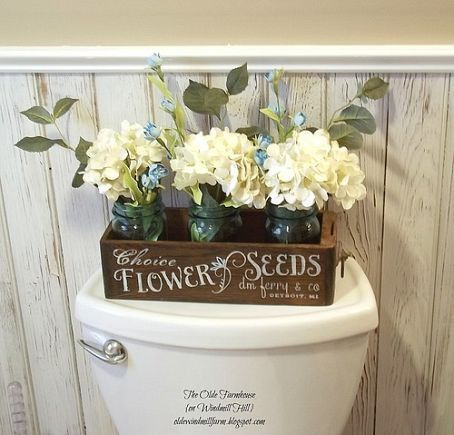 Make a small wooden box and put some graphic font work on it. Then add some mason jars with flowers. Awesome!