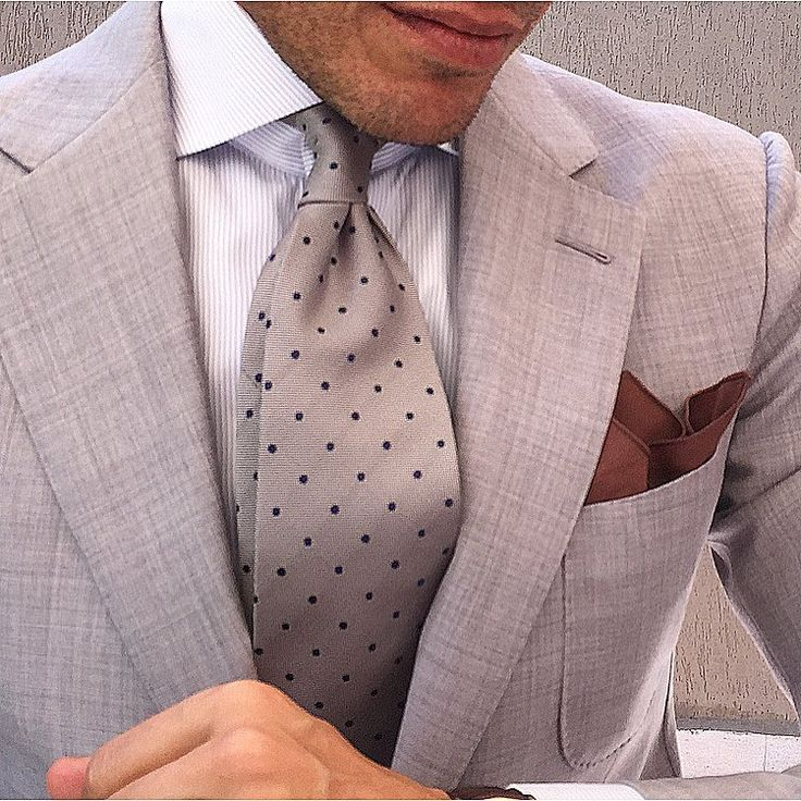 Concrete blazer, white dress shirt, concrete satin pindot necktie, brown kerchief, tanned face