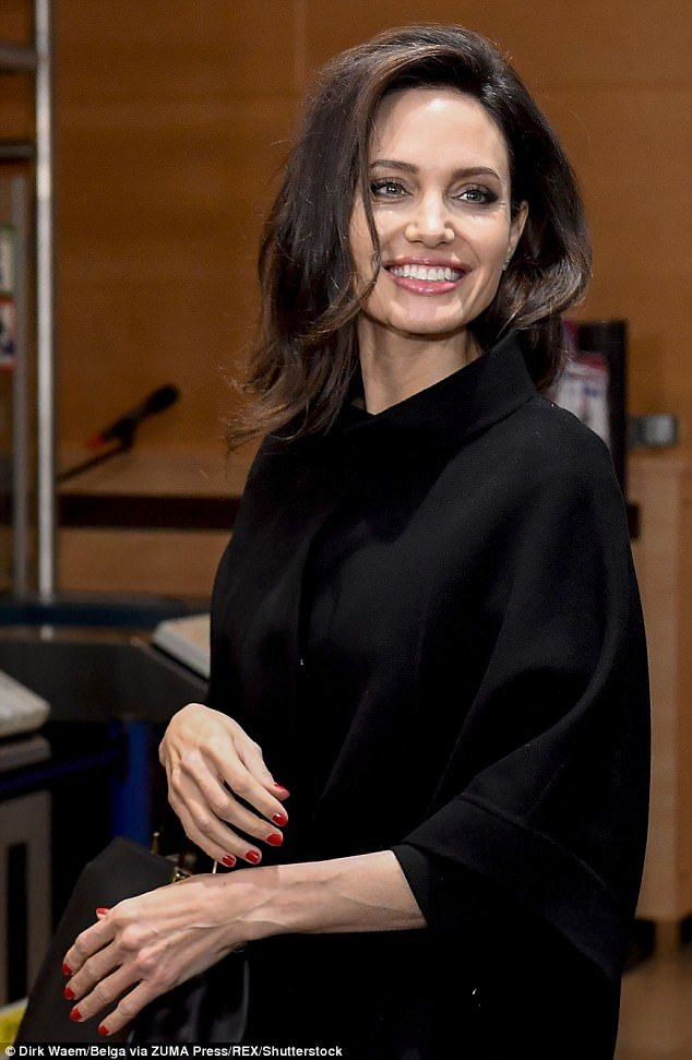 Smile: The visit to NATO HQ was the latest stop on Angelina's tour of Europe, with the star seen meeting with France's First Lady Brigitte Macron on Tuesday