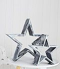Large and small grey and white decorative stars
