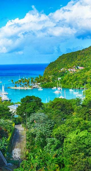 St. Lucia | Sit back and gaze upon the idyllic Marigot Bay, an historic landmark once described by author James A. Michener as the most beautiful bay in the Caribbean.