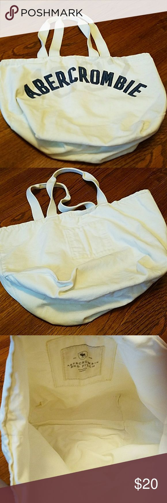 White Abercrombie Canvas bag Just a big o white Abercrombie and Fitch bag .  Very sturdy. Very Slightly dirty. Abercrombie & Fitch Bags Totes