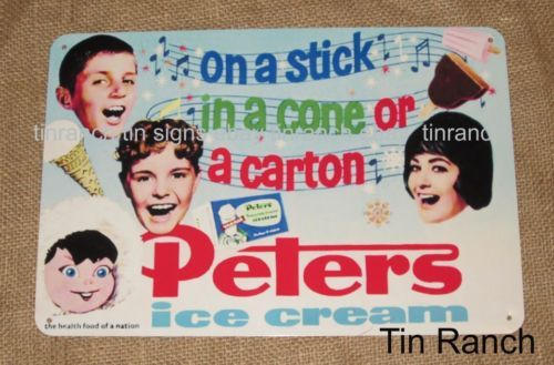 PETERS-ICE-CREAM-TIN-SIGN....fun old advertising. Love those floating heads!