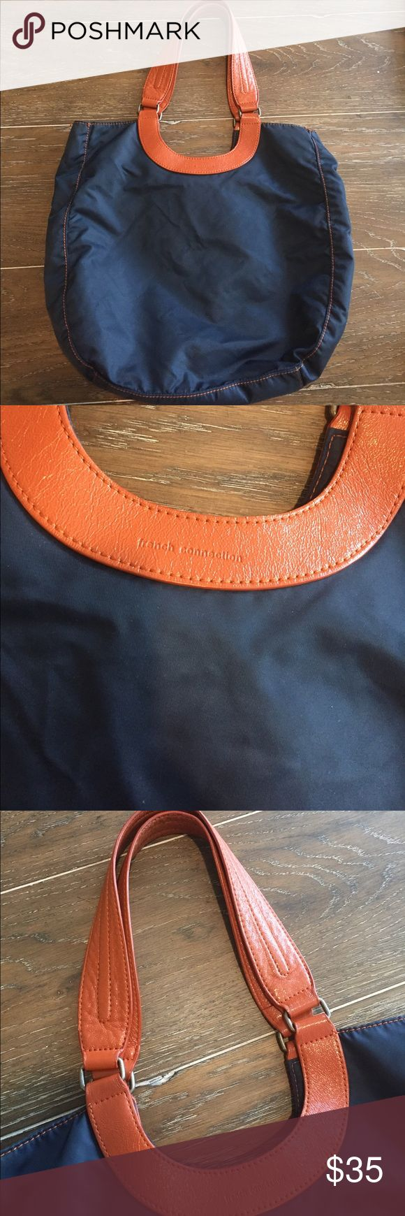 French Connection Nylon Snap Purse Excellent used condition!! This purse is the perfect daytime purse and can fit all your accessories. Navy Blue purse with brownish handles. Zipper pocket inside. French Connection Bags Shoulder Bags
