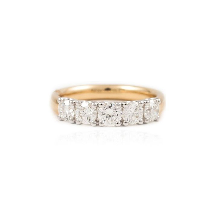 Timeless yellow gold five stone claw set eternity ring with round brilliant cut diamonds.