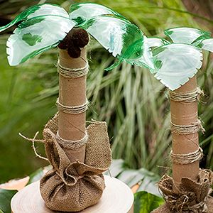 palm tree centerpieces from soda bottle, paper towel tubes, burlap, twine and brown pompoms