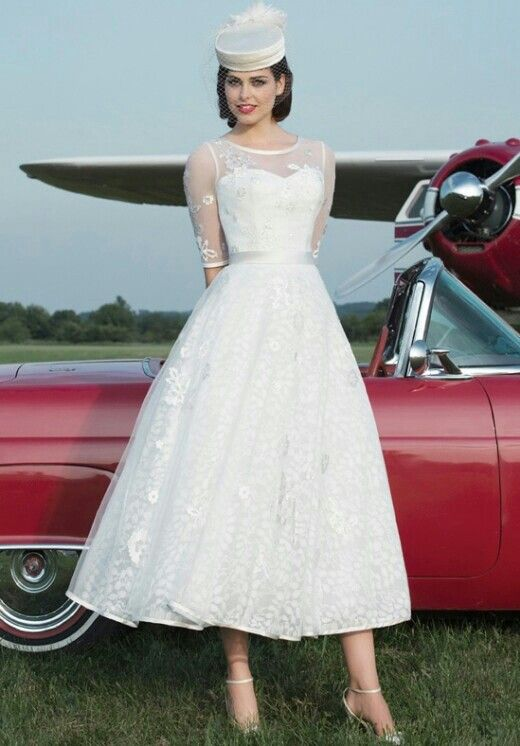 Stunning retro bride! This dress is incredible! :: retro bride:: Rockabilly wedding:: vintage bride:: retro wedding dress:: Rockabilly bride:: mesh sleeved wedding gown:: unique bride