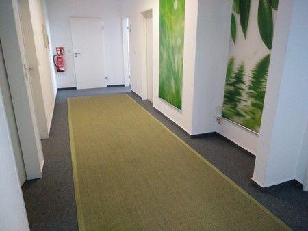 Ein wunderschöner gras-grüner Astra Manaus Sisalteppich nach Maß - eingefasst in einer grüne Bordüre