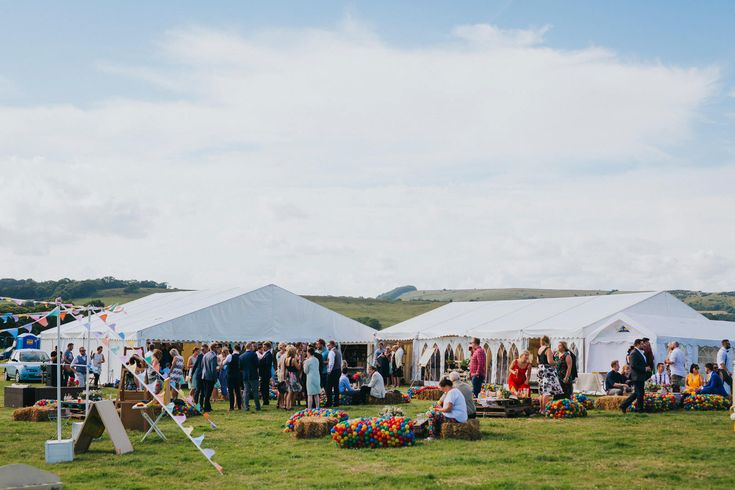 Plenty of seating, games, shelter, entertainment and drinks for guests at this festival wedding. Photo by Benjamin Stuart Photography #weddingphotography #festivalwedding #festivaldecor #weddingideas #outdoorwedding #guestentertainment #weddingentertainment