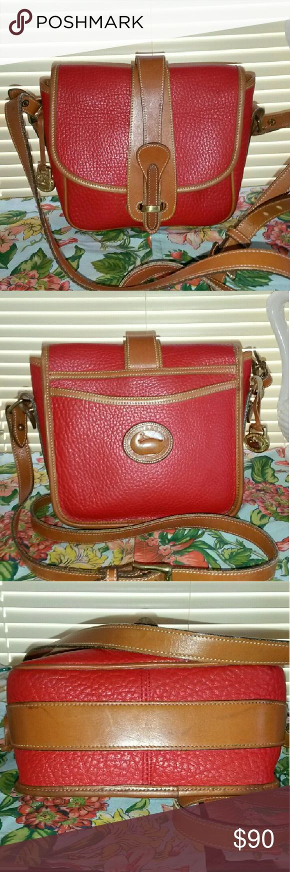 DOONEY BOURKE VINTAGE BINOCULAR BAG Gorgeous Red and British tan Vintage binocular bag. She shows no signs of piping damage, scuffs, marks or stains on the outside. The inside has ink spot on bottom of inside bag. Overall a beautiful bag to show off!! Dooney & Bourke Bags Shoulder Bags
