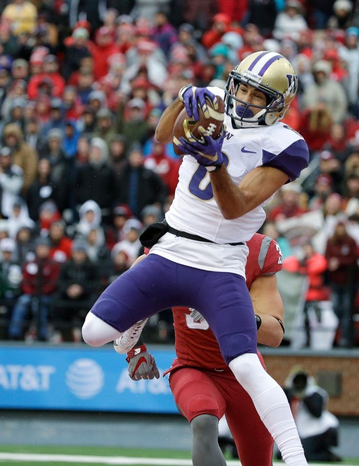 Washington wide receiver Dante Pettis makes a catch in front of Washington State linebacker Isaac Dotson for a touchdown in the first half of an NCAA college football game, Friday, Nov. 25, 2016, in Pullman, Wash. (AP Photo/Ted S. Warren)