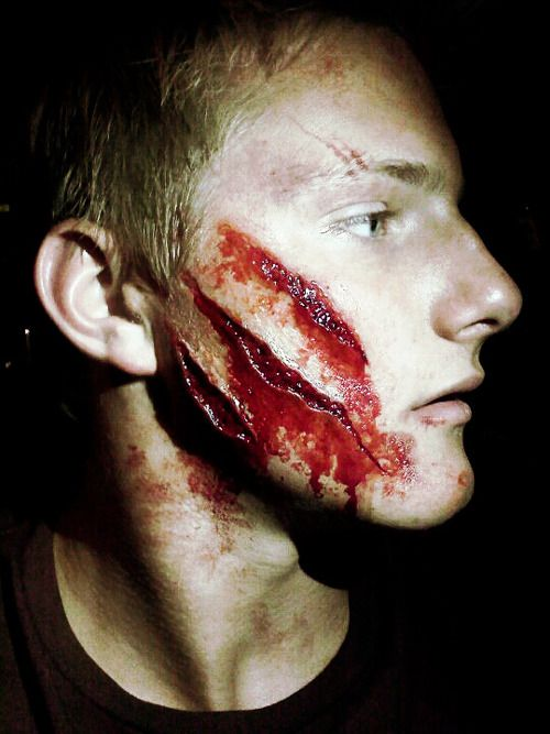 behind the scenes close up of Cato's face. WOW. awesome makeup job!