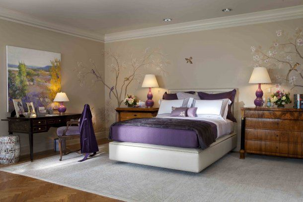 A touch of purple in the bedroom and I love the trees on the wall.