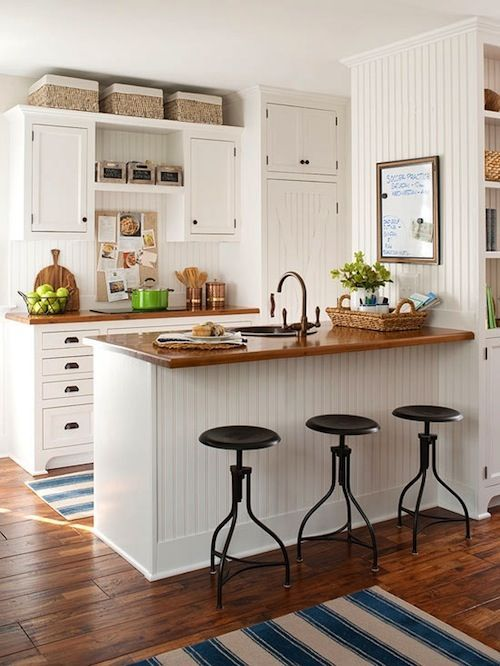 White cabinets with wooden countertops and floors!