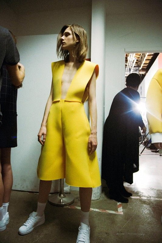 Canary yellow neoprene worn with Adidas Superstars at Jacquemus AW14 MFW.