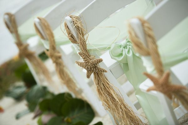 Starfish, grass skirts, and sea green sashes fit perfectly with a beach wedding.Photo Credit: Minerva Photography