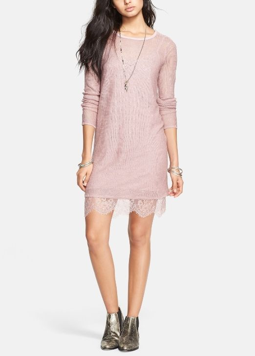 The hint of lace creates a romantic style to this pink sweater dress.