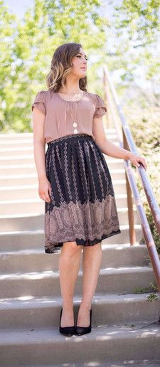A modest knee length black and tan knee length skirt with a gorgeous print…