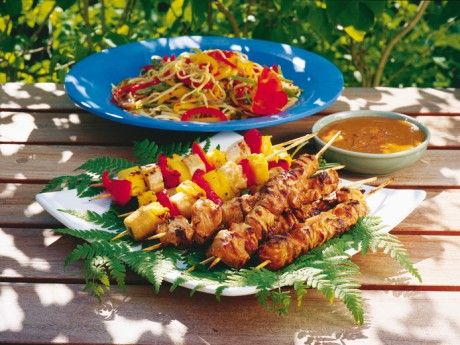 Skewers with noodle salad and satay sauce
