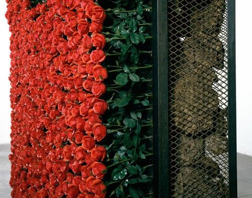 Chen Zhen, Le Produit naturel / Le Produit artificiel, 1991, metal, artificial flowers, Plexiglas, mirror screen printed, dung of cow, cm 297 x 170 x 55.