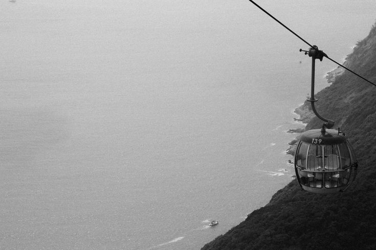 #aerial #black and white #boats #coast #gondola #lift #mountains #ocean #sea #view #water