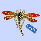 No jewelry collection would be complete without this lovely dragonfly 14K yellow gold rhodium-enamel brooches with 0.12 carat rubies and 0.05 carat diamonds with VS SI clarity and HI color quality! 5.1 gram.CONTACT US FOR MORE INFORMATION! T: 5148452900 OR info@eskimofire.com