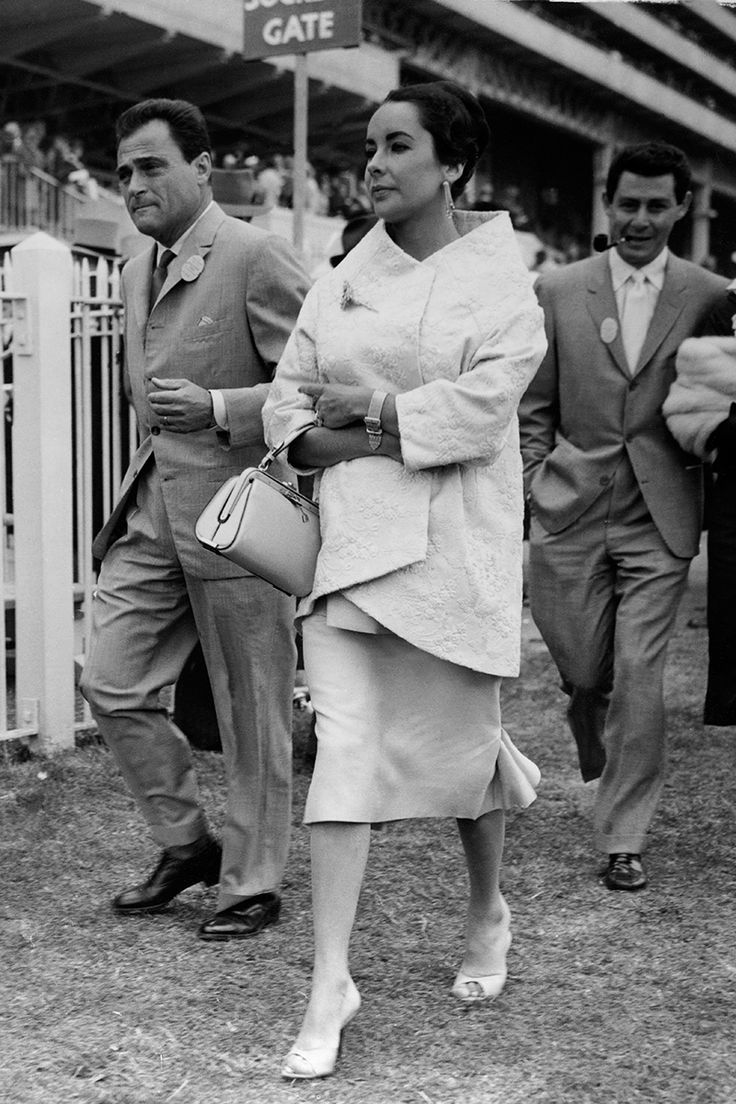 The Best Dressed Celebrity Baby Bumps in History  - ELLE.com omg epic pic of Mike Todd, Elizabeth Taylor and Eddie Fisher.