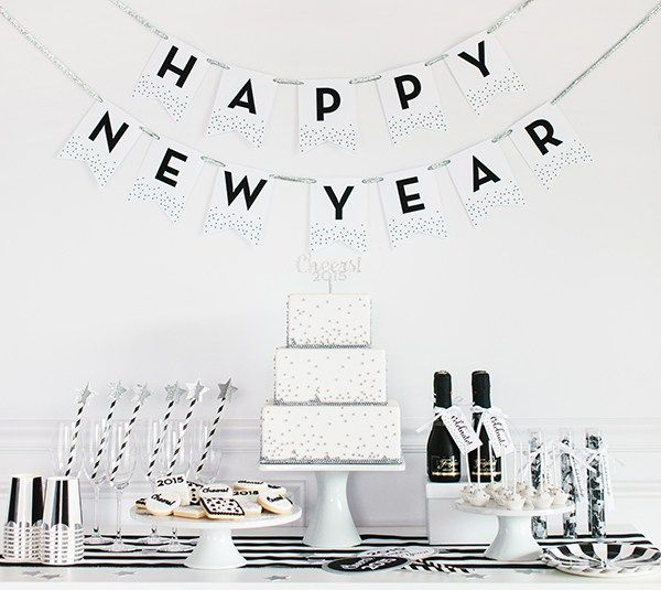 Happy New Year banner by The TomKat Studio. Make It Now in Cricut Design Space.