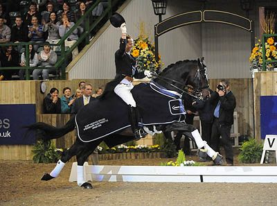 Carl Hester and Movistar thrill the crowds during their lap of honour  Bing Images