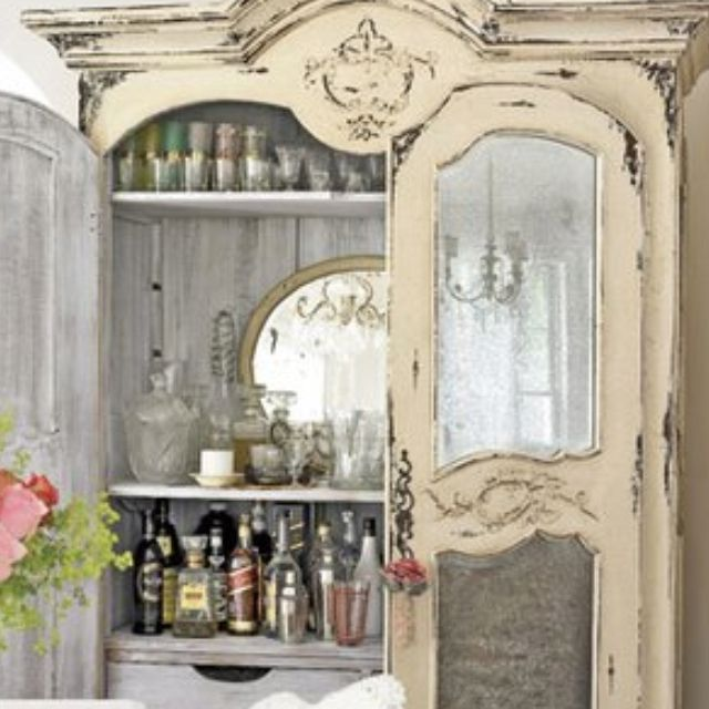 Shabby chic an old wardrobe ....great liquor cabinet