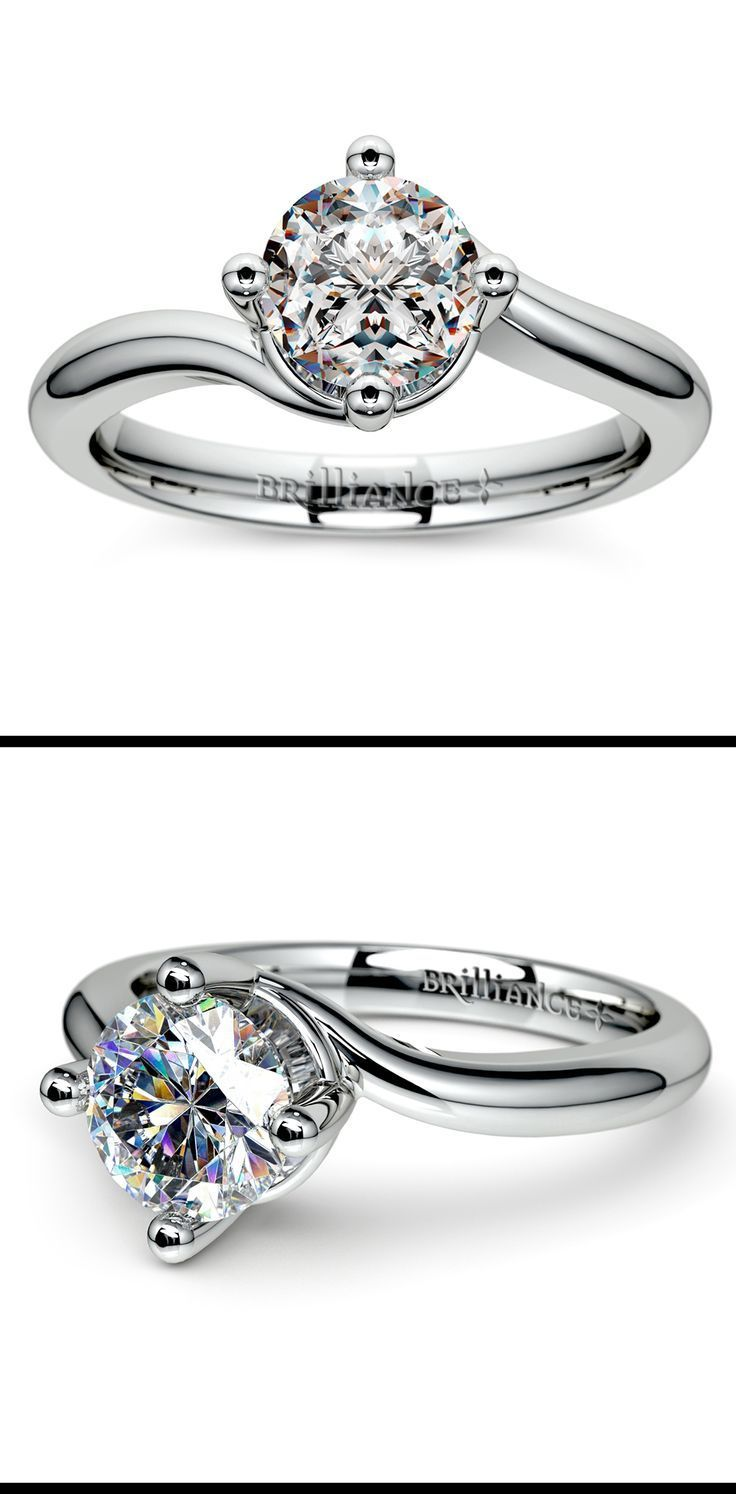 This unique platinum solitaire engagement ring features a swirl design allowing more light to enter the center diamond. A prong setting secures your choice of center diamond.