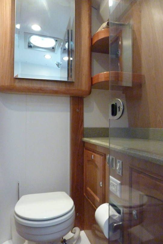 Marine Style Toilet With Internal Macerator. Medicine Chest Above. Ceiling  Fan Acts As Bathroom