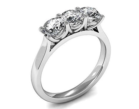 This 4 Prong setting plain three stone ring made using 18K white gold is sold for a sale price of £984 with free delivery offer at Diamonds Factory.