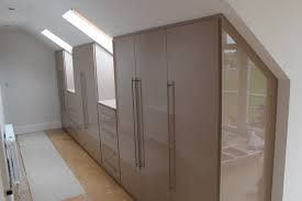 fitted wardrobes under eaves with drawers under windows