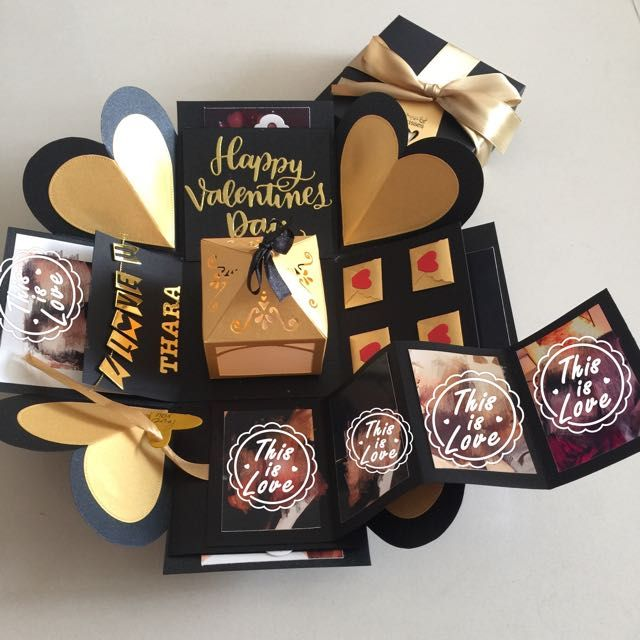 "Buy Valentine Explosion Box With Lighthouse, Pull Tab In Black & Gold in Singapore,Singapore. ----------- Info ------------- Size: 4x4""  Explosion box card with - 2 layers - a lighthouse  - 2 tags in 2 polder holders for u to pen yr greeting  - 4 customi Chat to Buy"