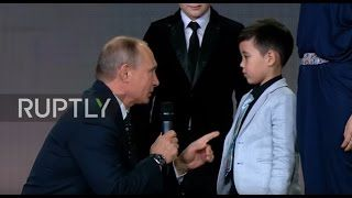 Russia: Putin quizzes child prodigies at Russian Geographical Society awards