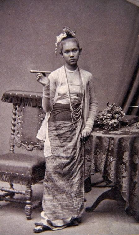 """Burmese lady with a cigar.  """"Frau mit Zigarre"""" c. 1875. Portrait by the German ethnologist and explorer Fedor Jagor who was in Rangoon collecting for Berlin museums."""