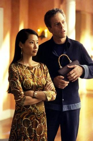 """Greg Germann as Richard Fish and Lucy Liu as Ling Woo in """"Ally McBeal"""" (TV Series)"""