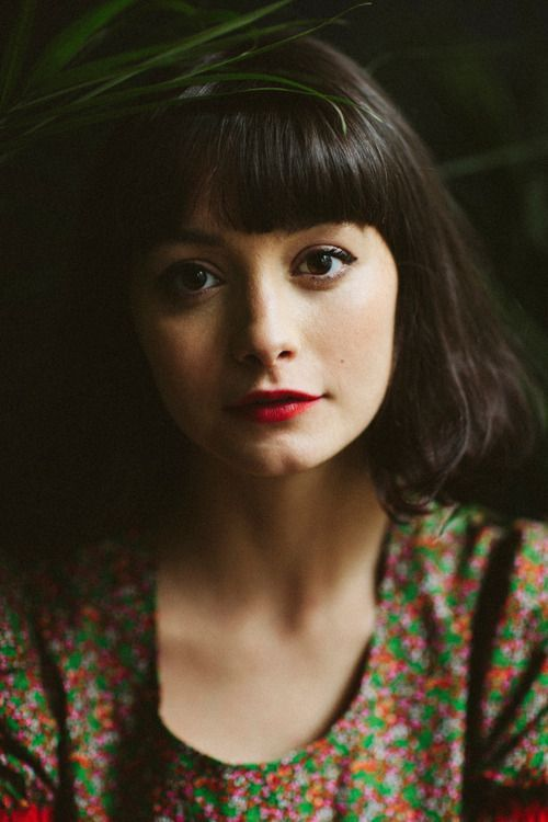 red lips - bangs - short shoulder length hair - brunette - female - front facing - shoulder up portrait