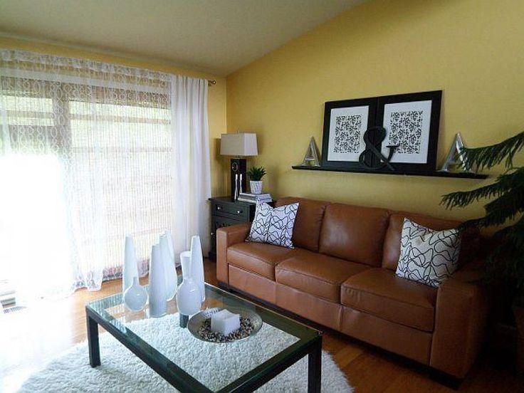 Yellow sofa with tan walls inspiring yellow living room for Living room yellow walls