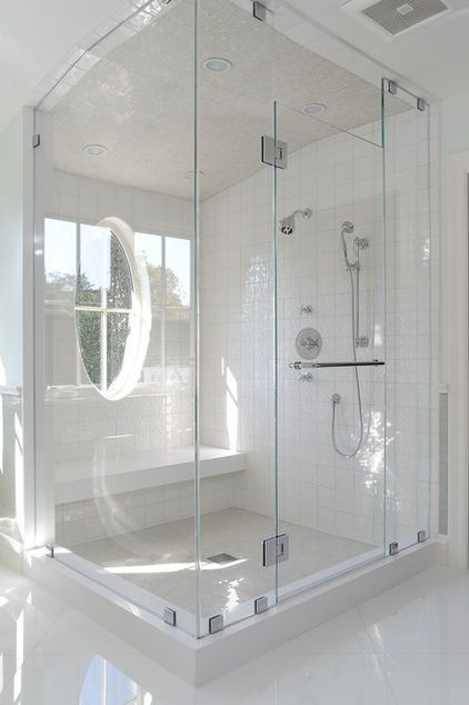 Beautiful Bathroom Showers...like the fact that underneath the seat the back has been filled in...so no deep dark area underneath!