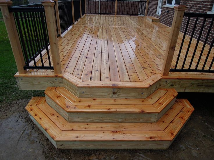 This is a 14' x 30' cedar deck, with a small bumpout that spills over into custom cascading steps. 440 square feet of space, including steps. We also installed black American Aluminum railing...