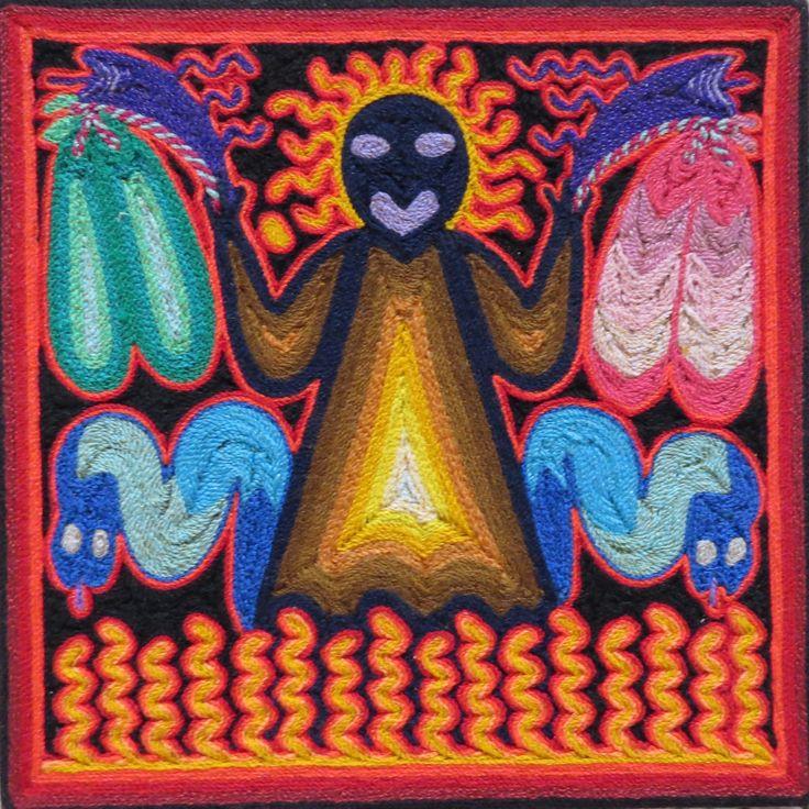 """El Dios llamado """"Tio Abuelo Fuego"""", sobre sale del fuego. En sus manos trae de diferentes tipos de ofrendas. Los serpientes representan guardianos del Tio Abuelo fuego. Santos Daniel c. Orillo Jimenez,Mezquitil,Jalisco, Mexico."""