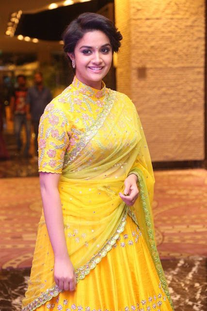 Keerthi Suresh Latest Hot Glamourous Yellow Traditional Saree PhotoShoot Images At Remo Movie Audio Launch  actress Keerthi Suresh