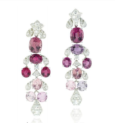 A PAIR OF SPINEL AND DIAMOND 'MAGNOLIA' EAR PENDANTS, BY CARTIER. Each designed as a cascade of cushion, oval and circular-cut spinels in various shades of pink, joined by pavé-set brilliant-cut diamond scrolling foliate links, to the similarly designed surmount, mounted in platinum.