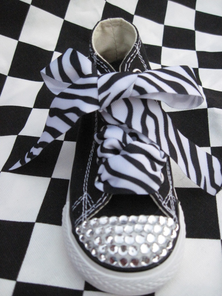 I'm doing this to a pair of black adult size converses soon! Just the rhinestone toes, not the zebra stuff...saw a girl tonight who did it! Looked so cute!!!! :)