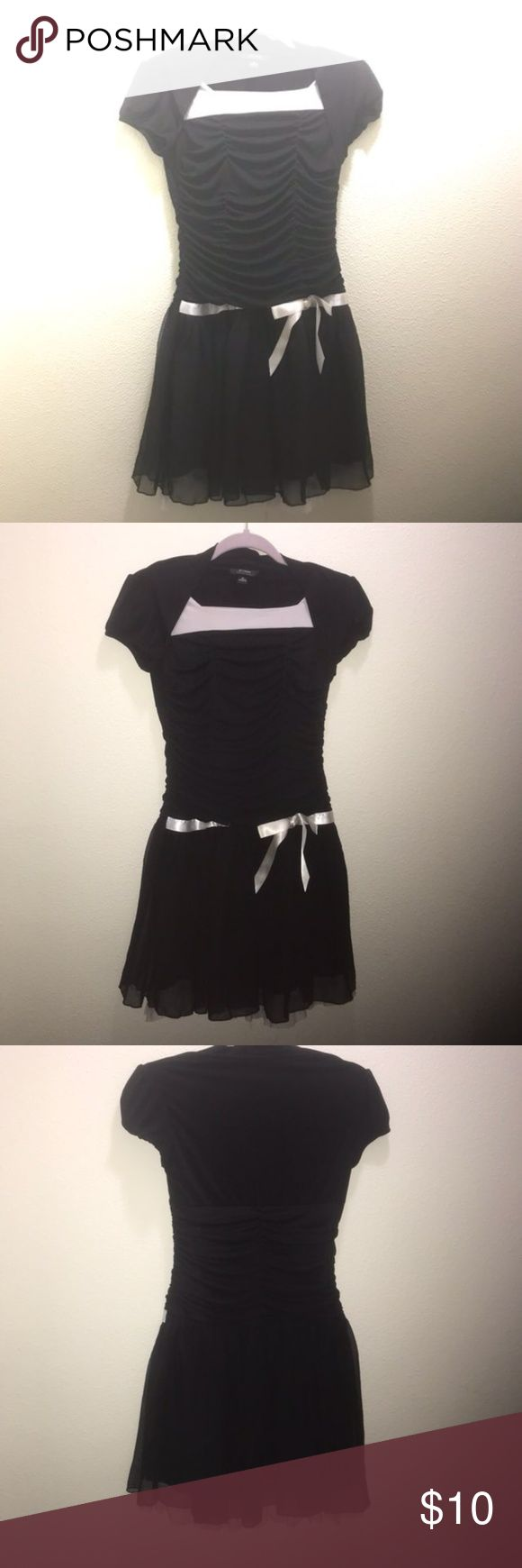 Girls Size 16 Black Stretch Satin Dress Girls size 16 party or holiday dress. Good condition with no holes or rips, some fading/color transfer on the white neckline from washing. Black and white Tulle hem. B Wear Byer Girl Dresses Formal