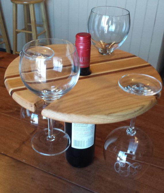 This beautiful wine bottle and wine glass holder holds four wine glasses which slide into slots around the circle to hang until they are needed,