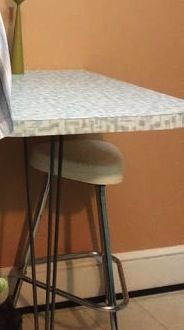 """buy one """"hair pin"""" table leg and a thick slab of wood then laminate it with your choice of laminates. Screw to wall with a chair on either side. Bam retro table on the cheap. Well at least it won't be as steep as $500.00"""